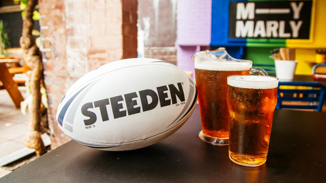 A football next to a jug & pint of beer in the Beer Garden
