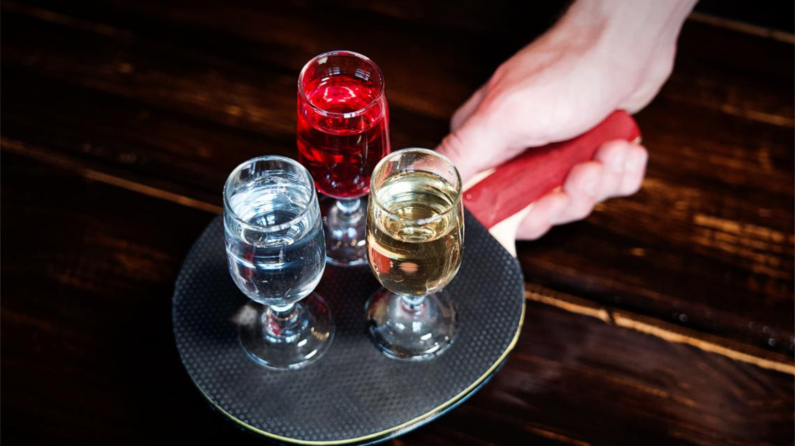 Haus made schnapps served on a ping pong bat